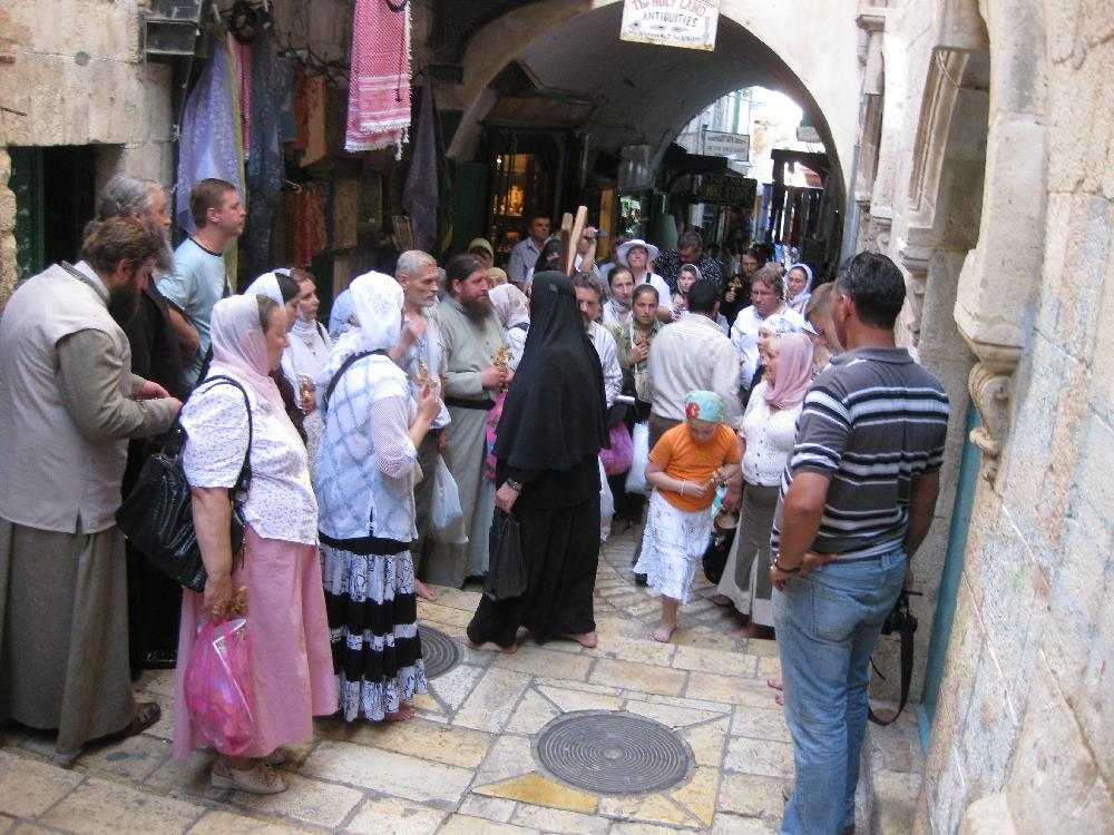 Pilgrims going through the city
