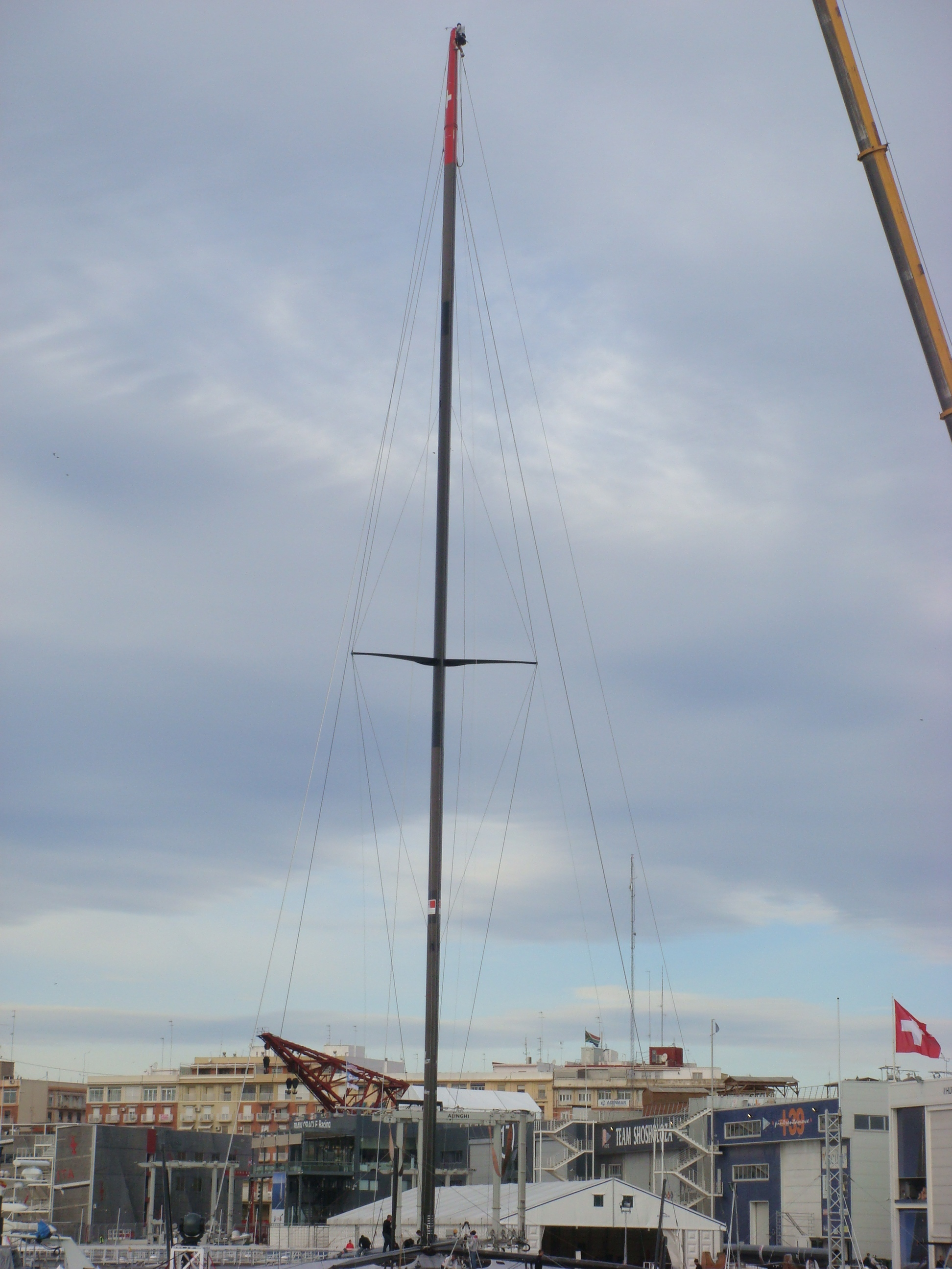 Alinghi steps her mast in Valencia